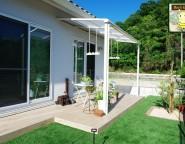 リゾートチックな新築外構!ココスヤシのある玄関まわりと人工芝の中庭 1/9NEW!